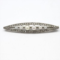 Broche 1910 en platine, diamants et perles
