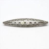 Broche 1910 en platine, diamants et perles